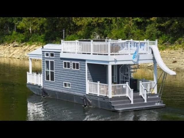 This Houseboat Looks Normal At First Glance Is Hiding One Of The Coolest Secrets Around