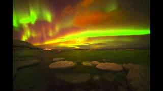 Red and Green 'Christmas' Auroras Light Up Skies Over Sweden | Video