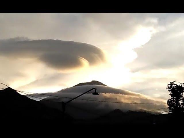 Large UFO Hovers Over Mountain In Indonesia