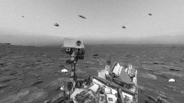 Several Strange Black Objects Or UFOs Surrounding The Curiosity Rover On Mars?
