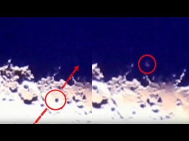 Spinning UFO crosses the dark side of the Moon before disappearing into deep space