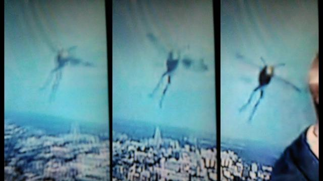 While watching the weather report on television the witness filmed this strange winged creature