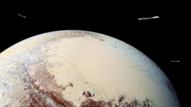 Were Large UFOs Seen Surrounding Pluto?
