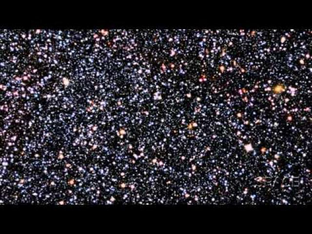Dwarf Galaxy, Hiding In Plain Sight, Frames Distant Large Galaxies | Video