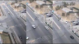 Two cars suddenly levitate in the middle of the traffic
