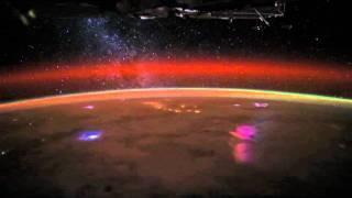Over Earth: Comet Lovejoy Meets Milky Way