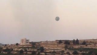 Huge UFO Sighting Massive Metallic UFO Or Drone Over Afghanistan 2012