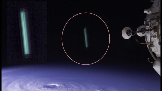 Long Green UFO Near Space Station In NASA Photo