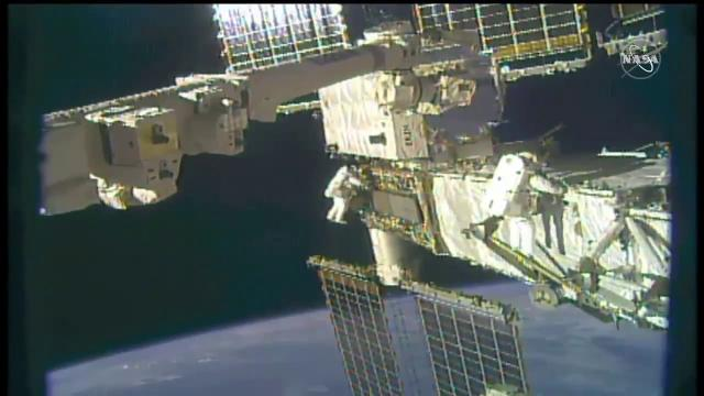 See NASA spacewalkers working outside space station to swap batteries