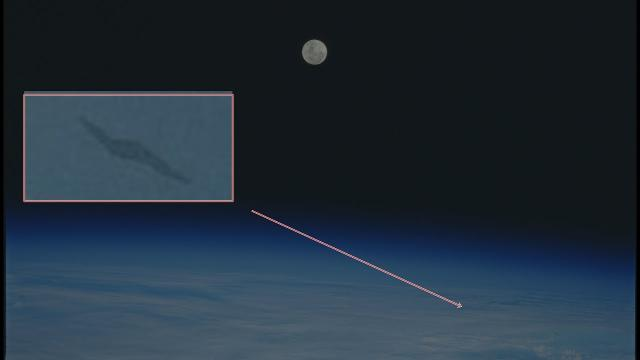 Black lightning bolt UFO Seen From Space Shuttle Discovery