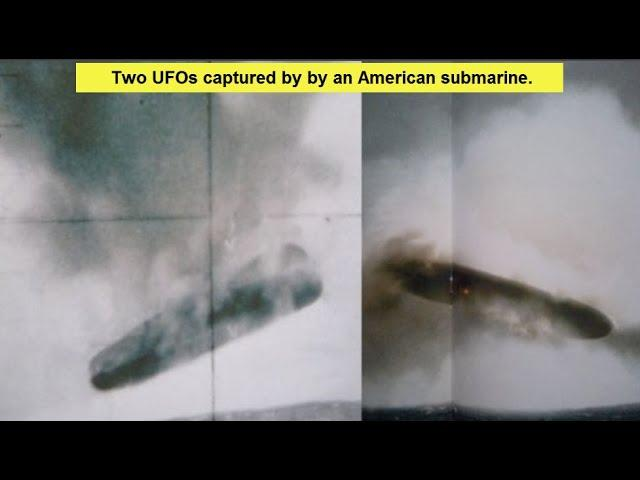 Huge Cigar shaped UFO emerges from the ocean