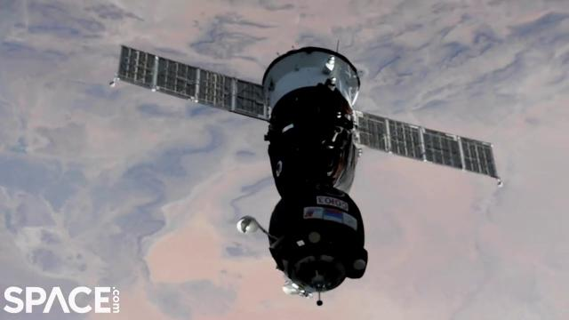 Crewed Soyuz spacecraft docks with space station in time-lapse video