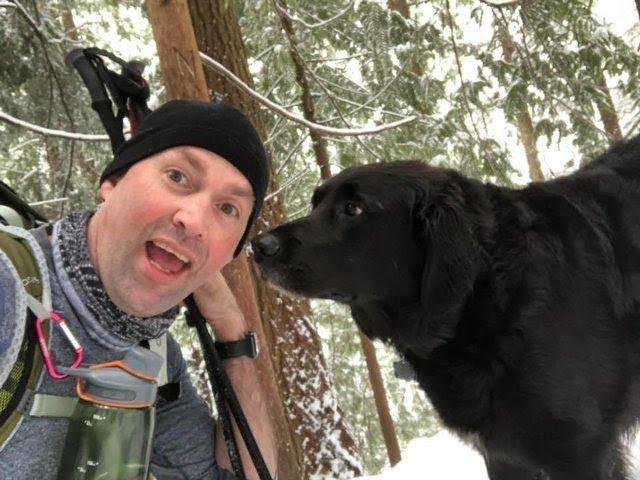Strange Dog Joins Couple On Hike And Then They See What's Written On His Collar