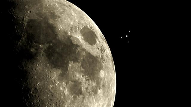Incredible Footage Of A Strange Object Or UFO Near The Moon?
